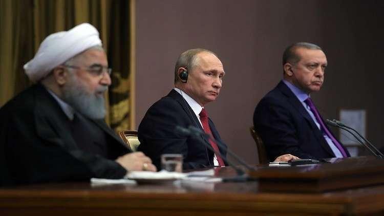 رجب طيب أردوغان وفلاديمير بوتين وحسن روحاني
