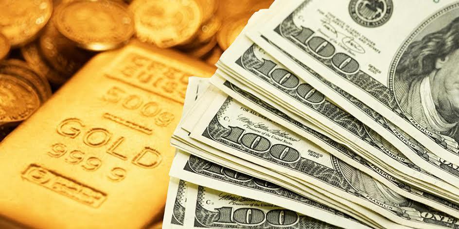 الذهب يتراجع والدولار يرتفع