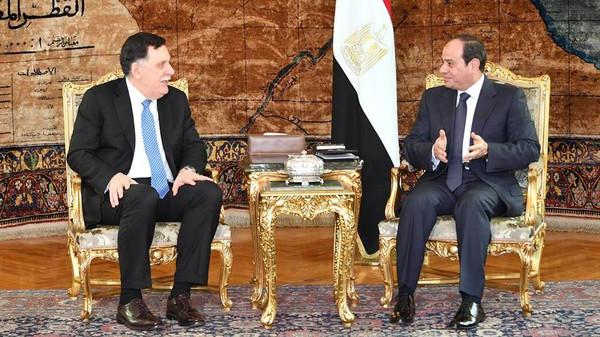 الرئيس المصري عبد الفتاح السيسي ورئيس المجلس الرئاسي الليبي فايز السراج