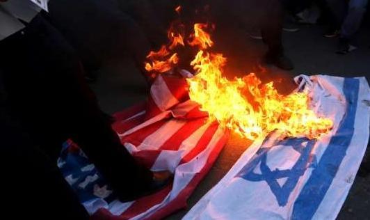 حرق علم الاحتلال والأمريكي - أرشيفية