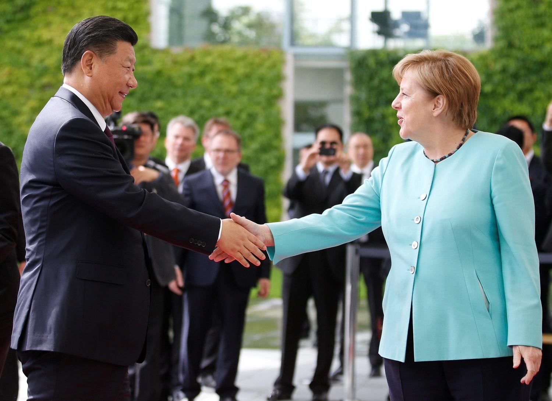 الرئيس الصينى تشى والمستشارة الألمانية ميركل (أرشيفية)