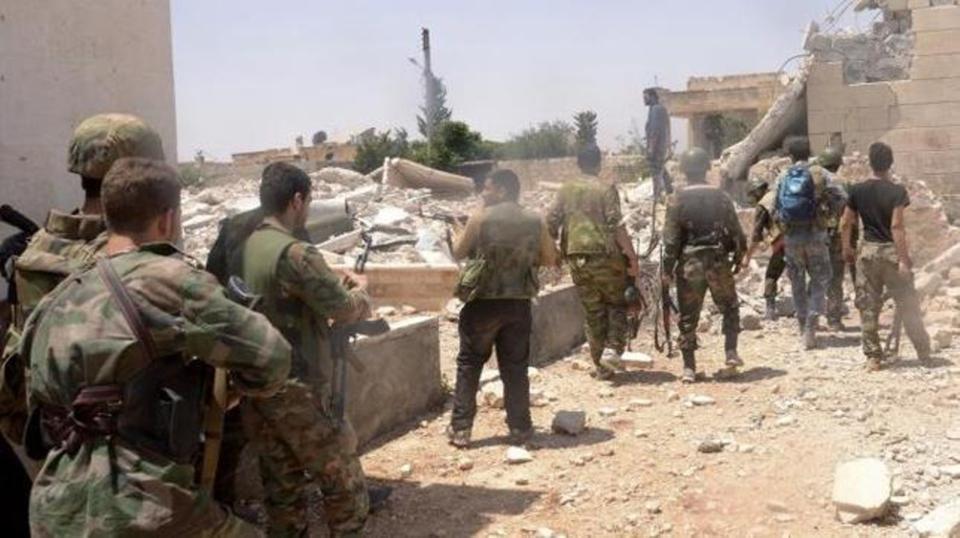 قوات تابعة للنظام السوري بمدينة البوكمال