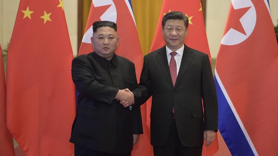 الرئيس الصينى ونظيرةه الكوري الشمالى
